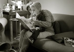 Mom reading a book to son